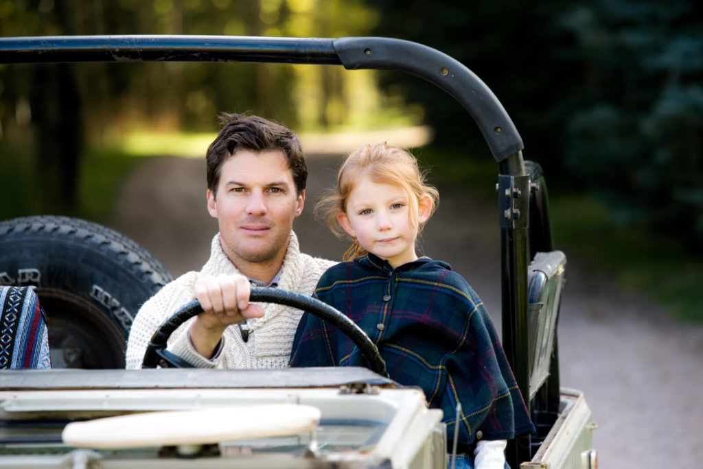 portrait of a dad and a young girl in a vintage truck taken by Michele Cardamone