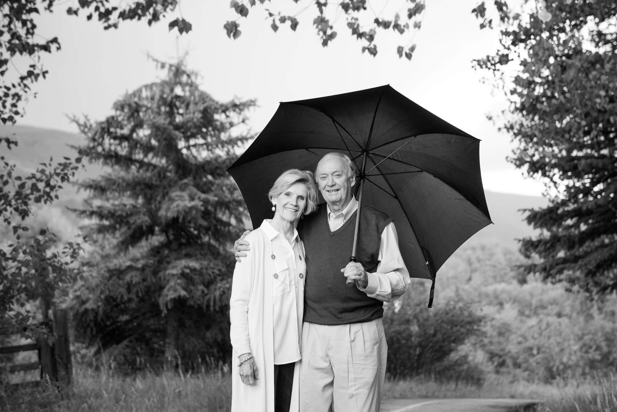 black and white photo of an older couple in a field