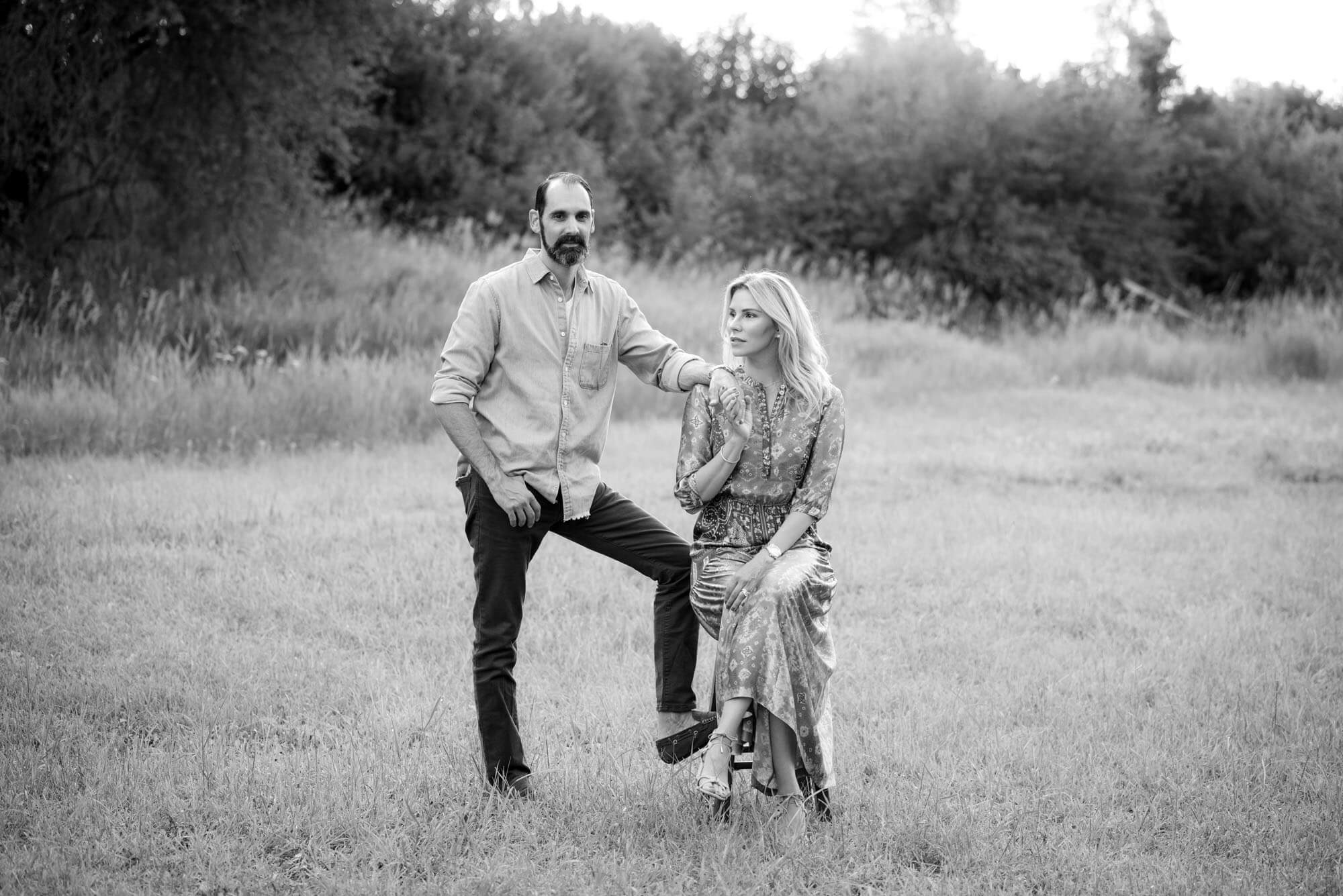 black and white photo of a couple in a field