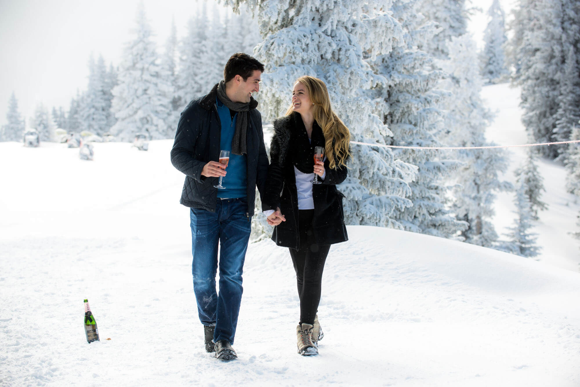 photo of a couple walking in the snow taken by Aspen photographer Michele Cardamone