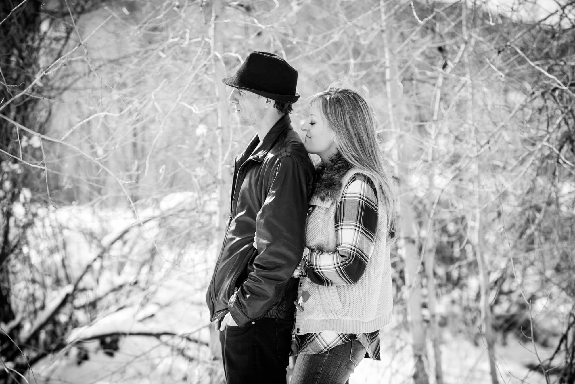 black and white photo of a couple in the snow taken by Aspen photographer Michele Cardamone