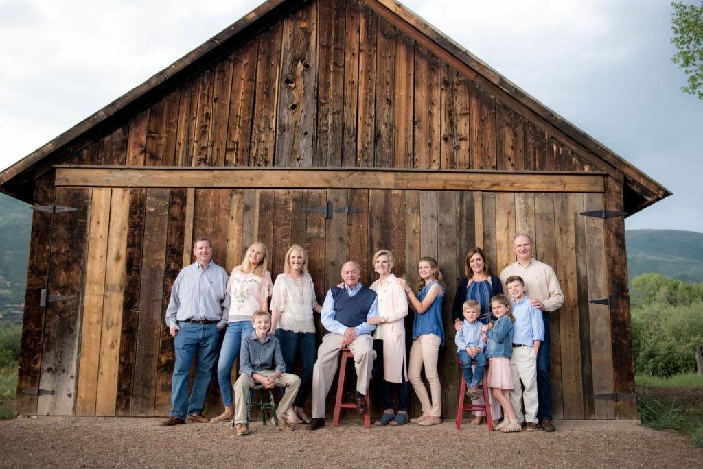 family portrait taken in front of a barn taken by Michele Cardamone