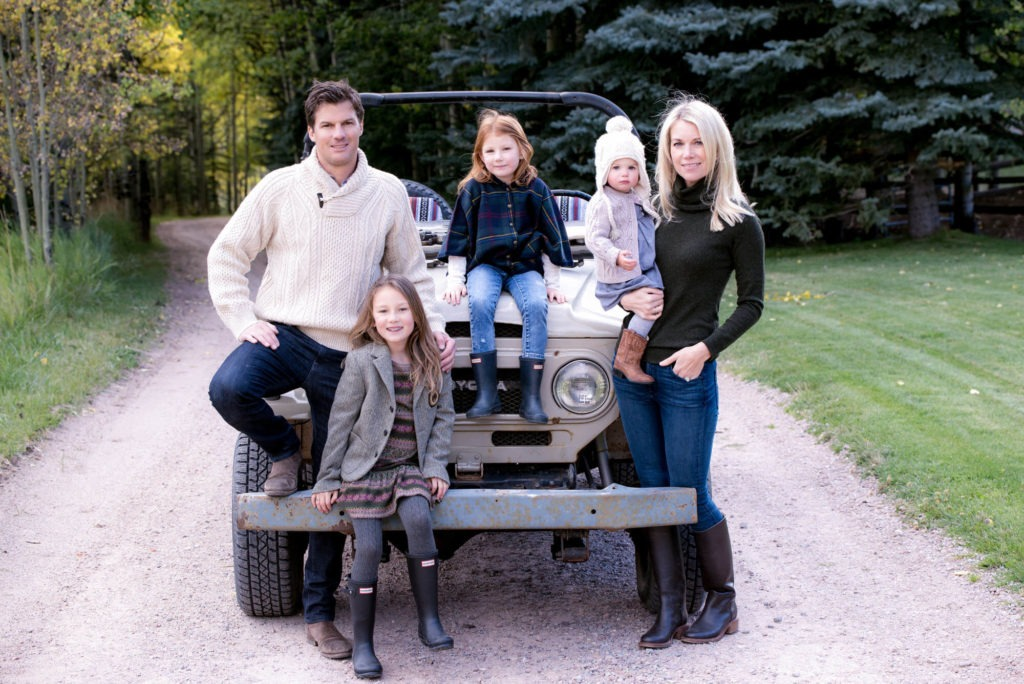 family portrait outside in a driveway with an old trucktaken by Michele Cardamone