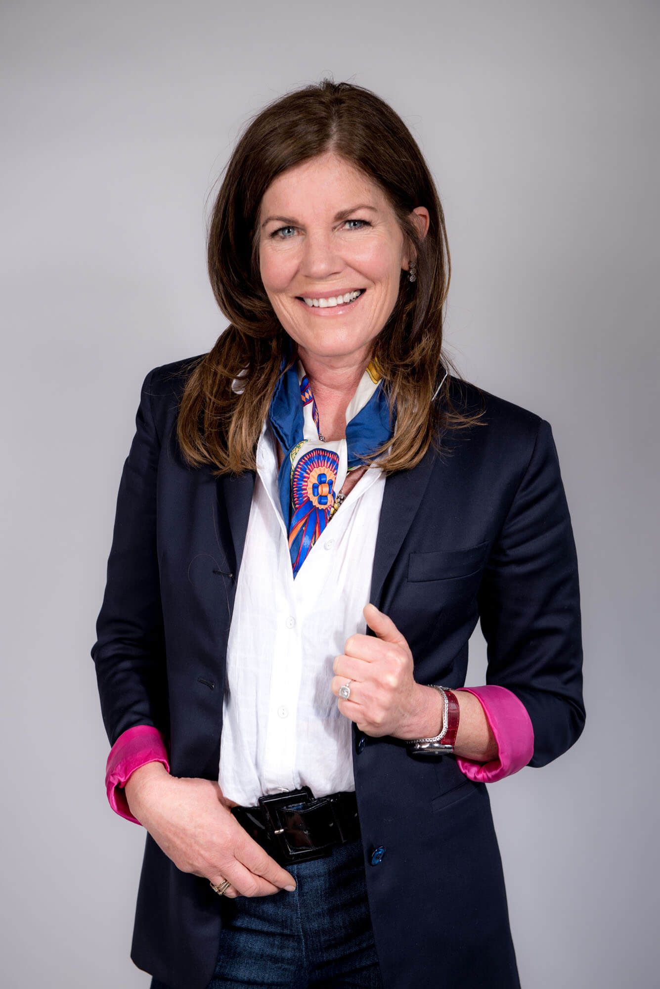 headshot of a women in business attire in a studio