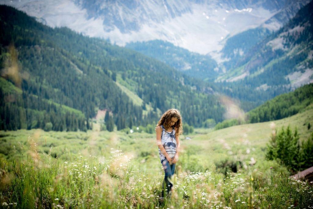 portrait of a girl in a mountain field taken by Michele Cardamone