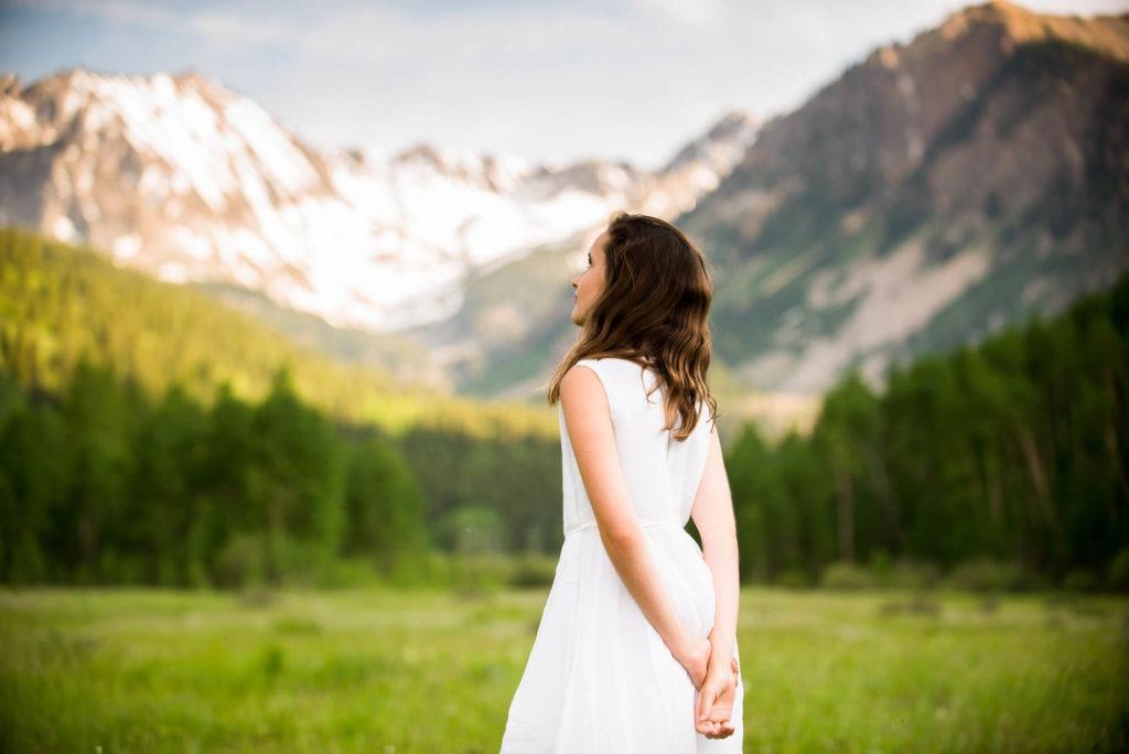 portrait of a teenage girl in a mountain field taken by Michele Cardamone