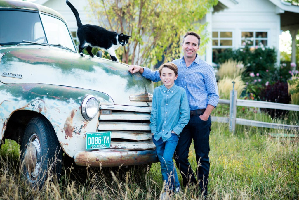 father and son portrait in front of an old truck photograph taken by Michele Cardamone