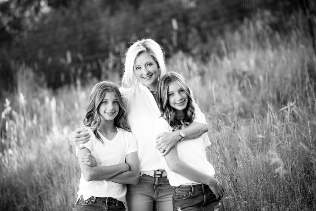 black and white portrait of a mother and two daughters photograph taken by Michele Cardamone