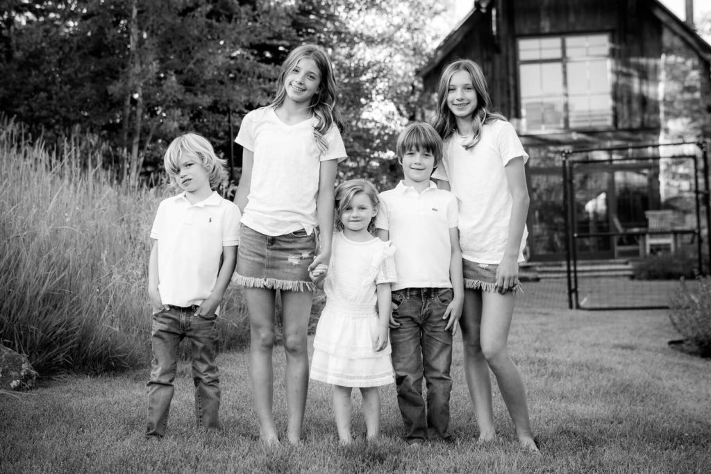 Outdoor portrait of siblings and cousins holding hands