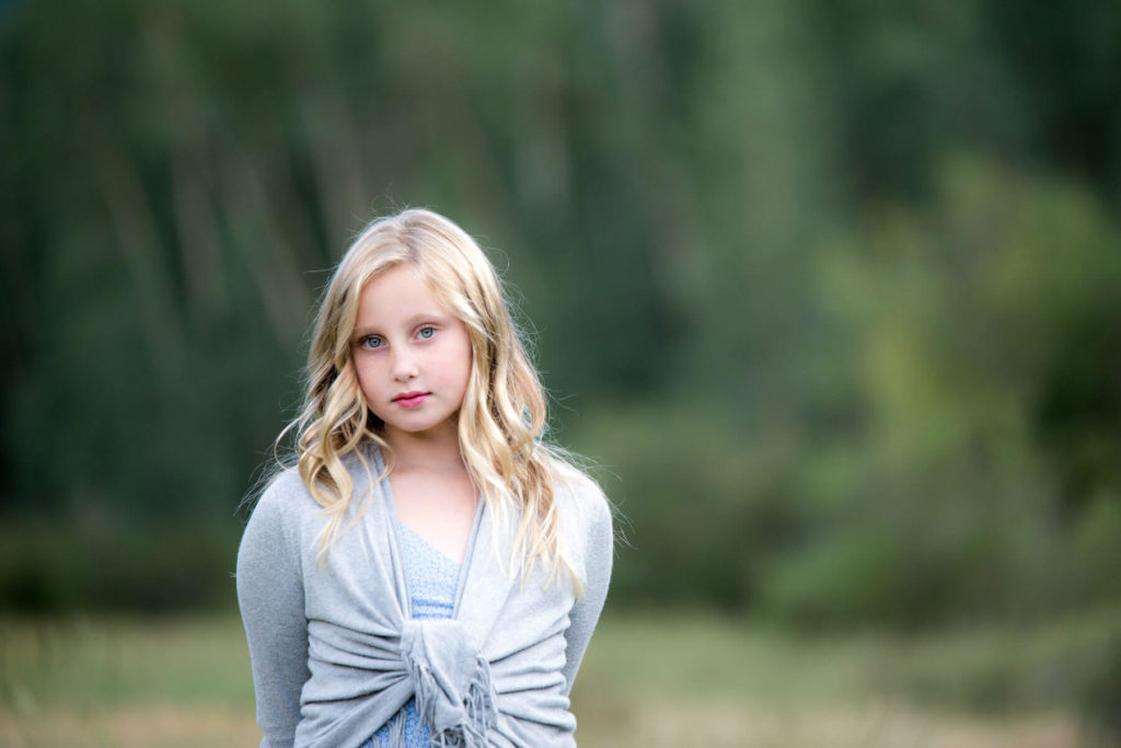 Young blonde girl in a field