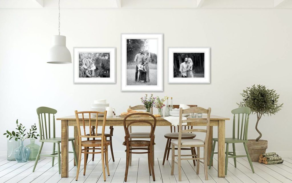 Framed family portrait gallery in a dining room