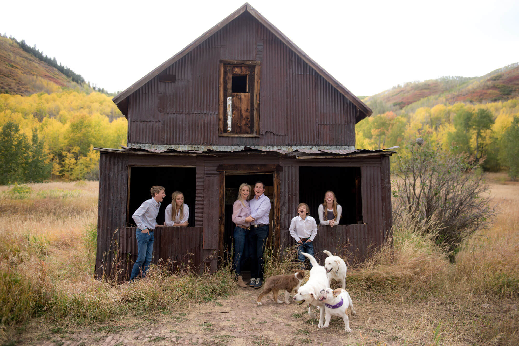 Family portrait including pets at an old vacant cabin