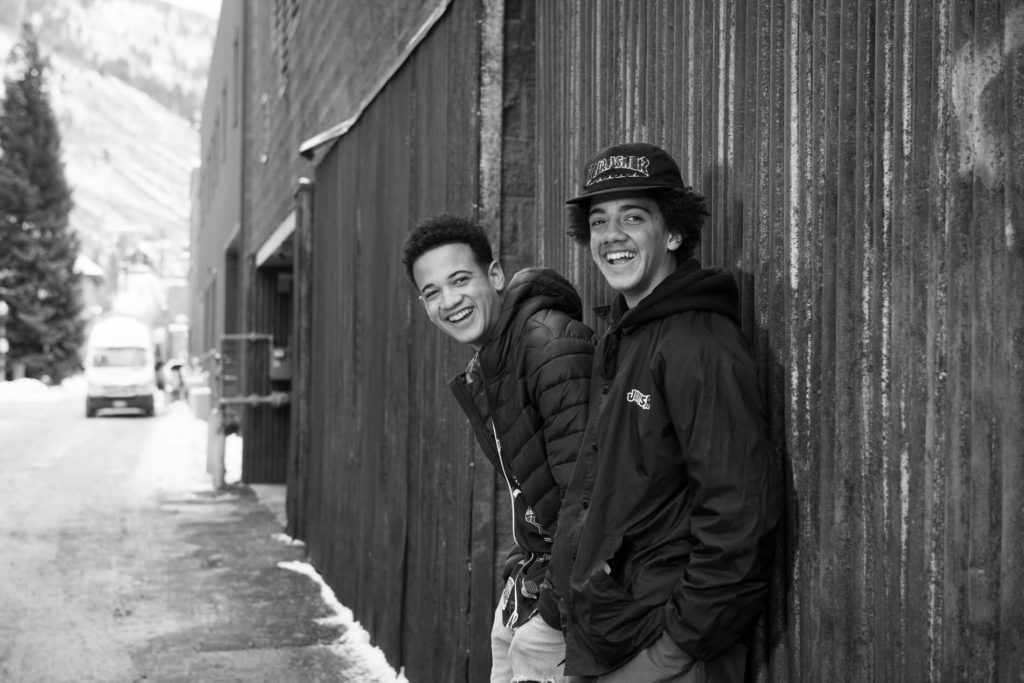 Brothers in an aspen alley laughing