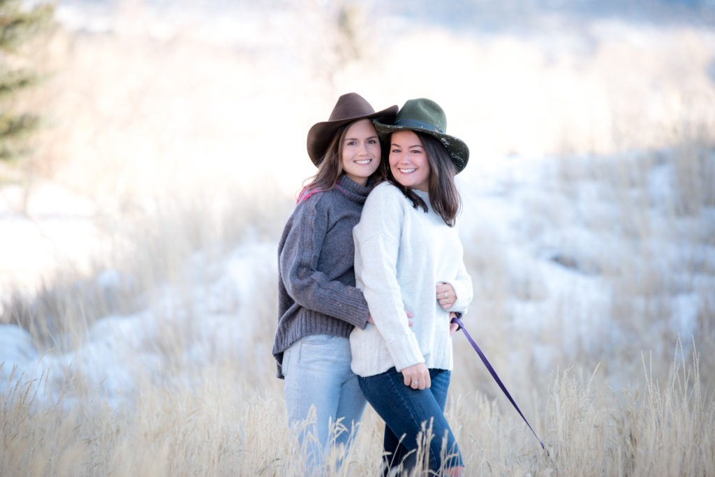 sisters in cowboy hats