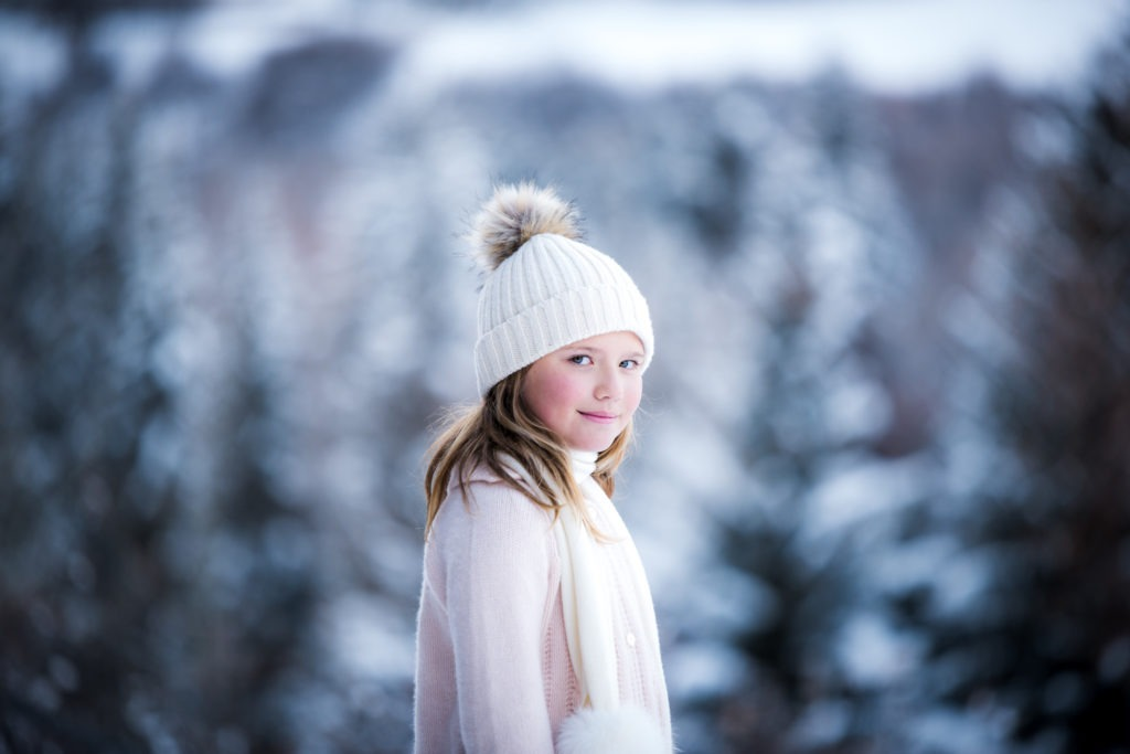 winter portrait of young girl in a hat