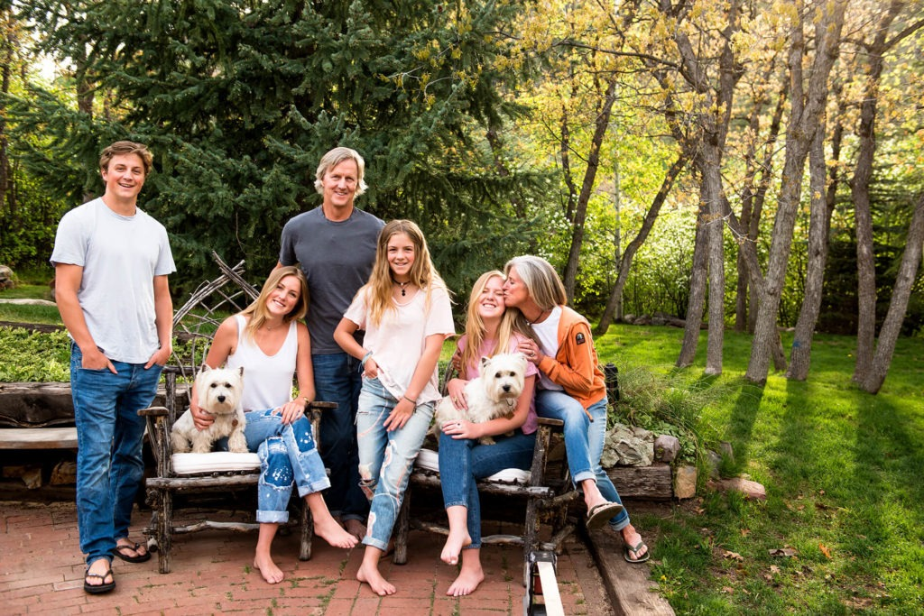 Family portrait at home in backyard with dogs