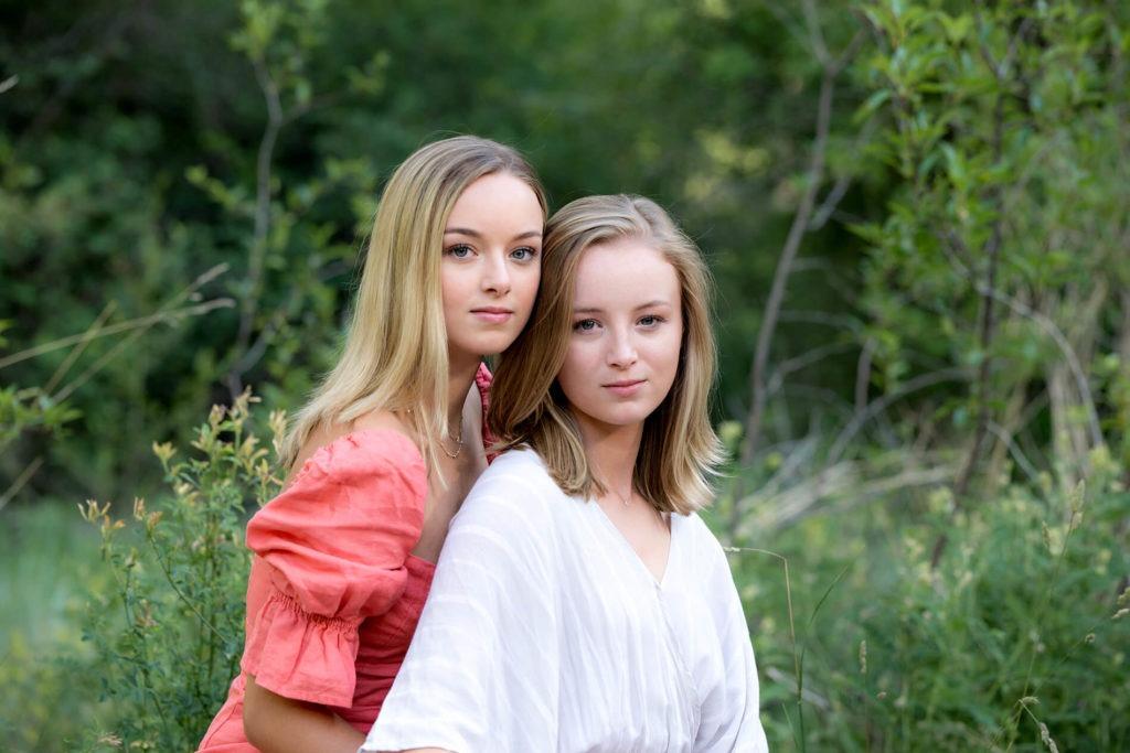 Sisters posing outdoors