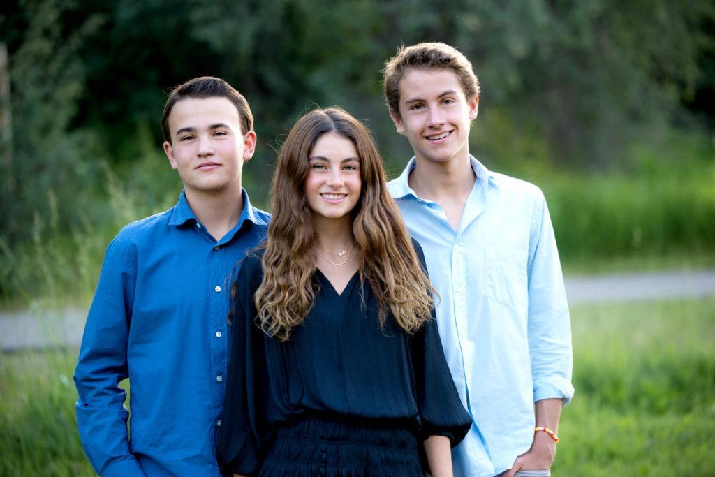 siblings posting for a portrait in Aspen