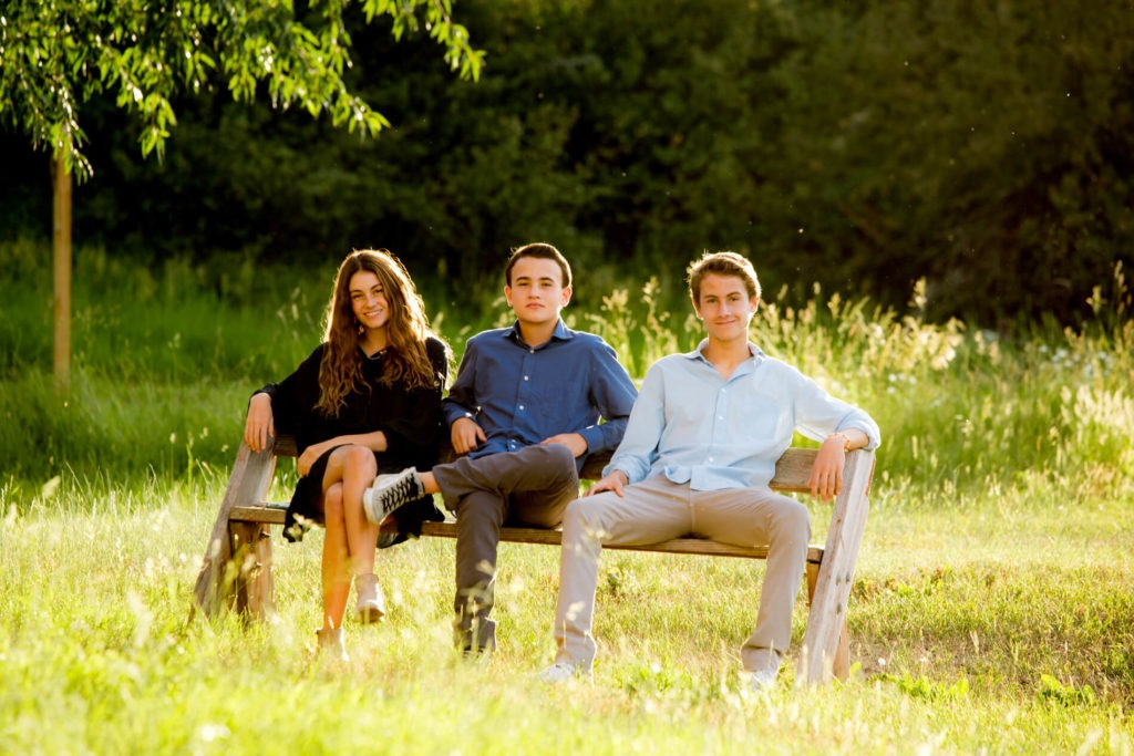 siblings on an outdoor bench