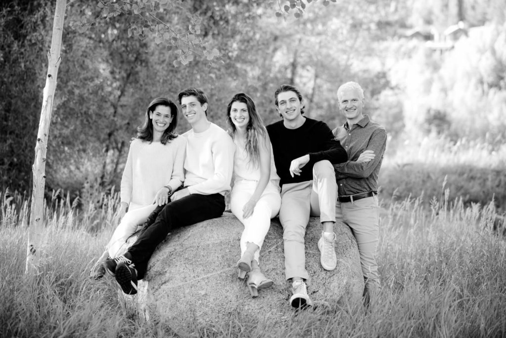 Colorado outdoor family portrait sitting on a rock