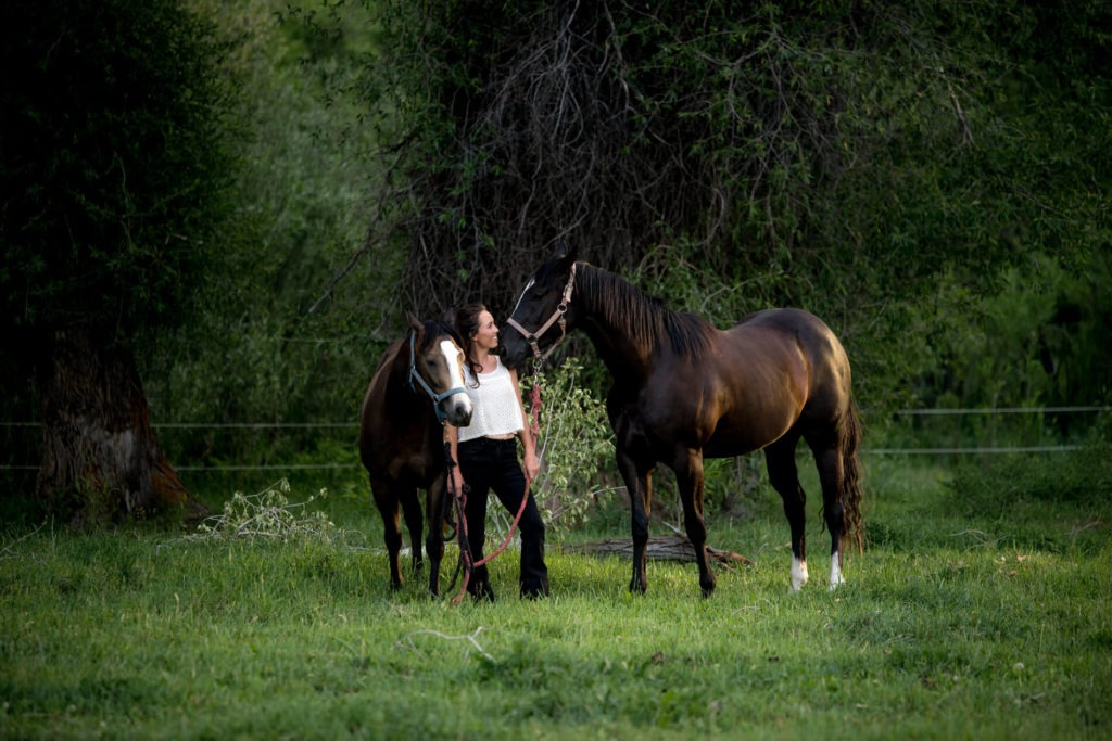 A girl with her horses in Colorado