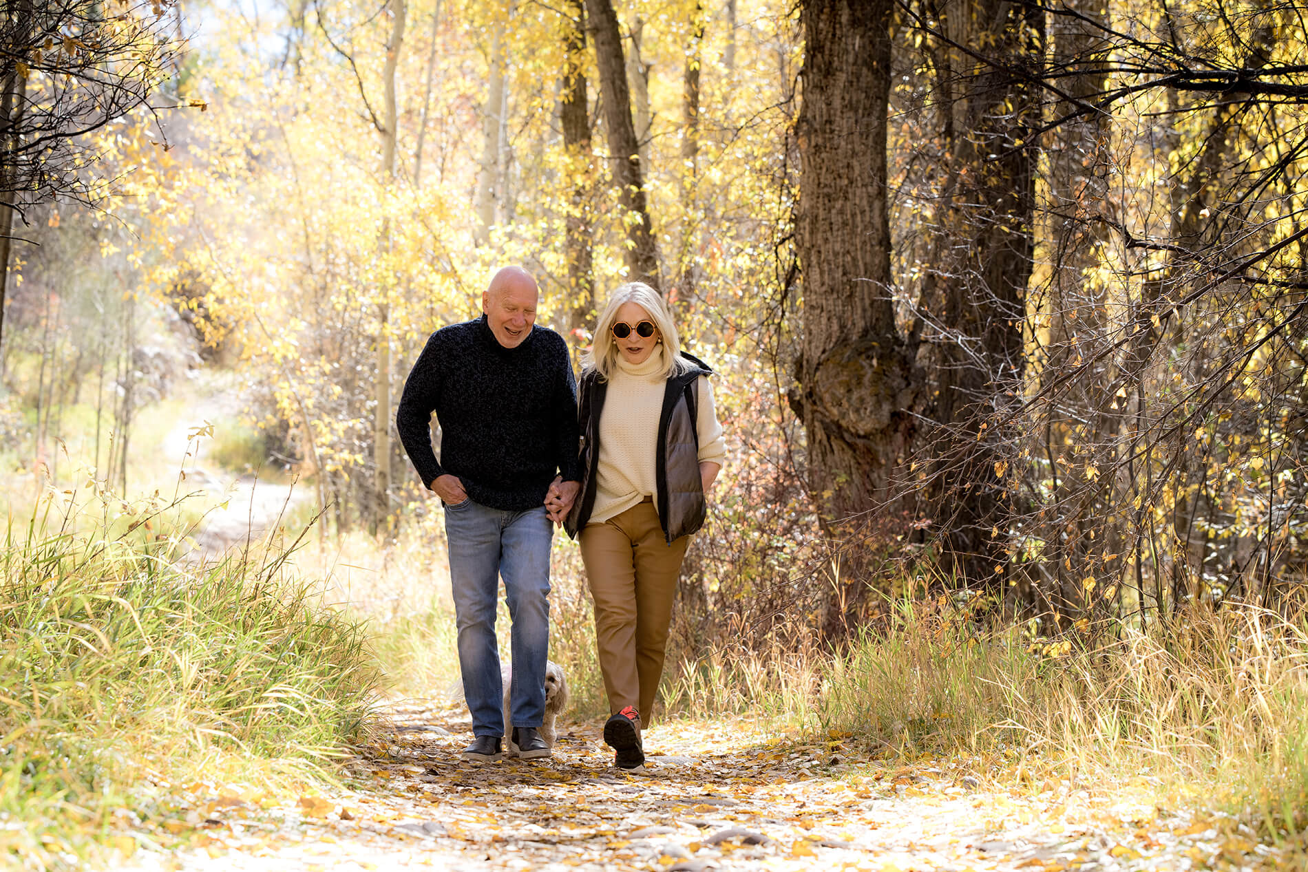 older couple of a walk in the fall