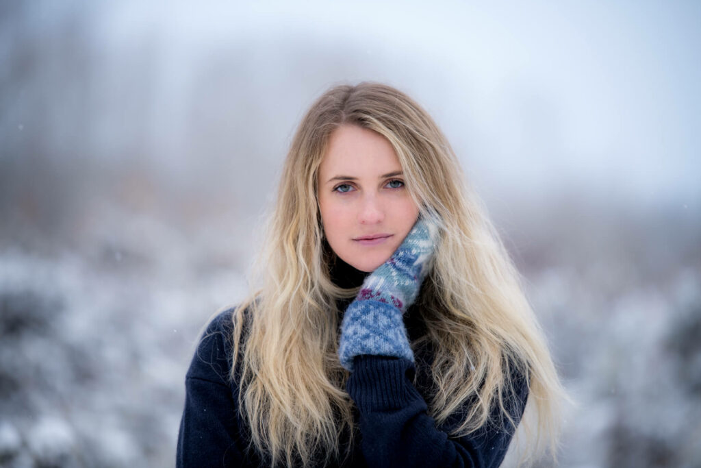 Snowy portrait of beautiful girl